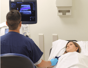 studying scans with dr and patient