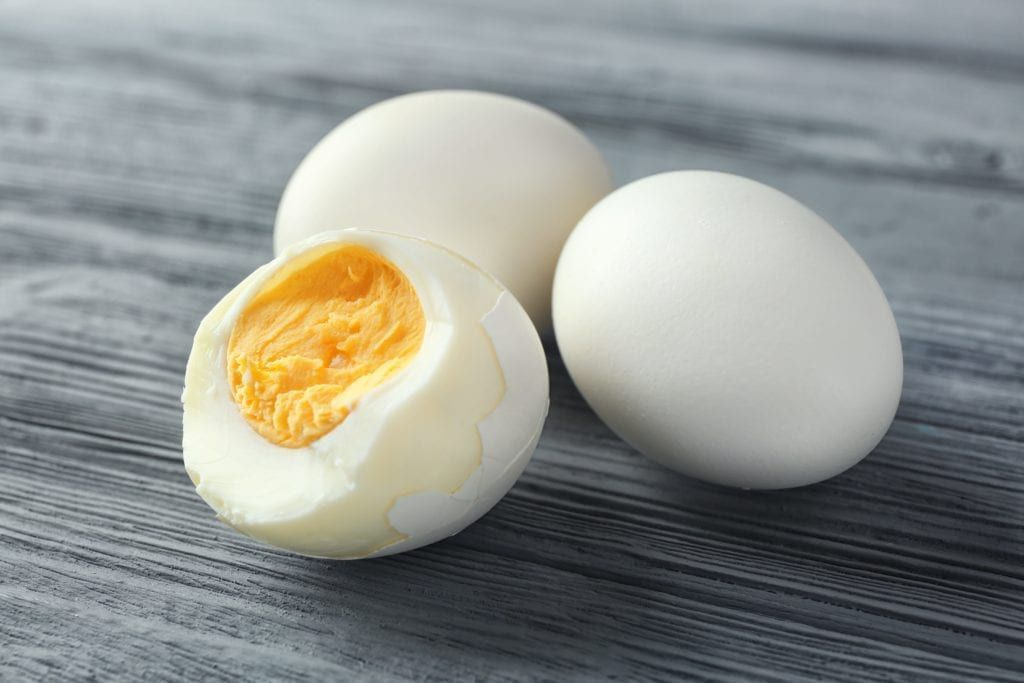 hard boiled eggs against a grey wooden background