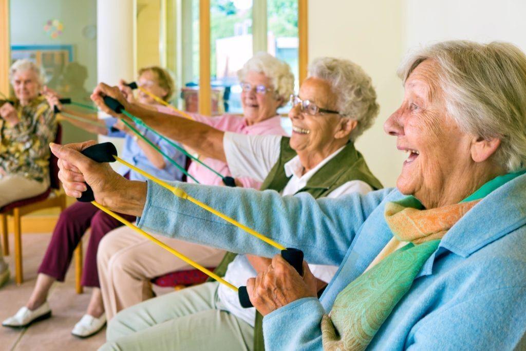 a group of senior women exercising their upper body