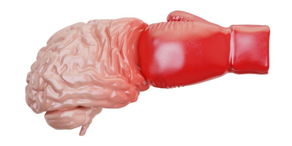 boxing glove punching a fake brain