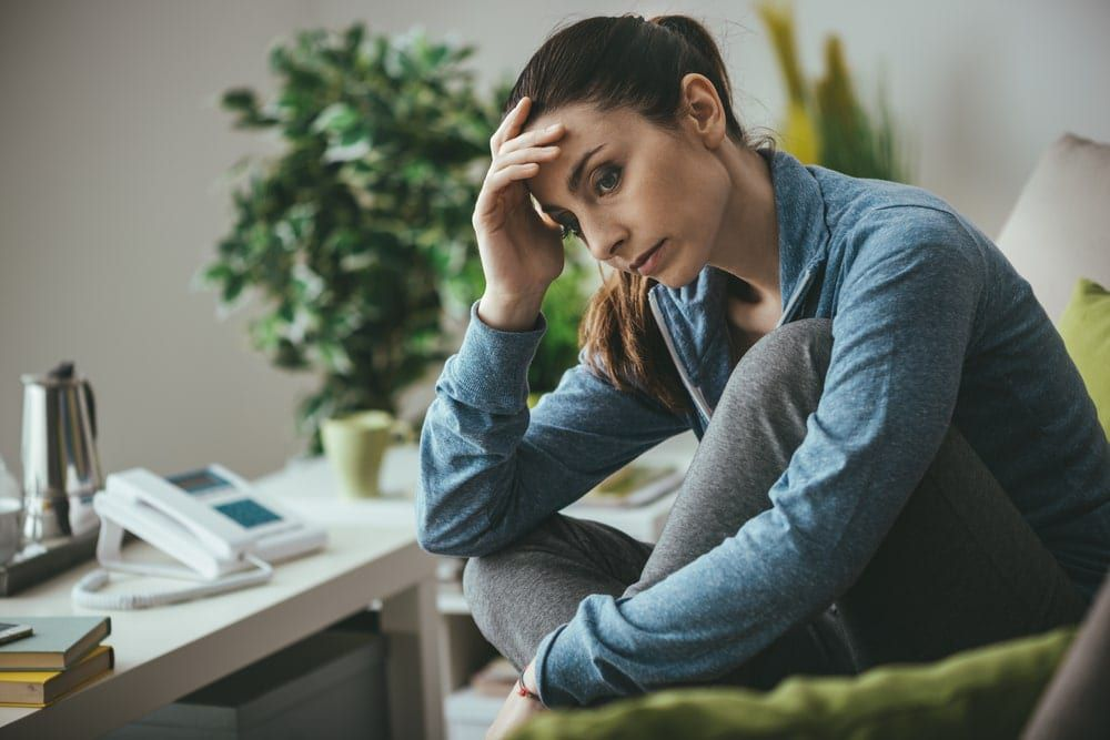 woman sitting at her desk looking lost